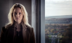 Sofia Helin playing Saga Norén in The Bridge, with the Öresund Bridge, linking Malmö and Denmark, behind her.