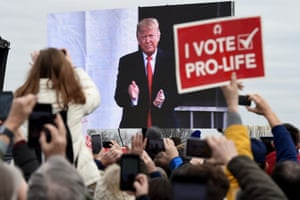 "Pro-life demonstrators listen to US President Donald Trump as he speaks at the 47th annual ""March for Life"" in Washington, DC, on January 24, 2020."