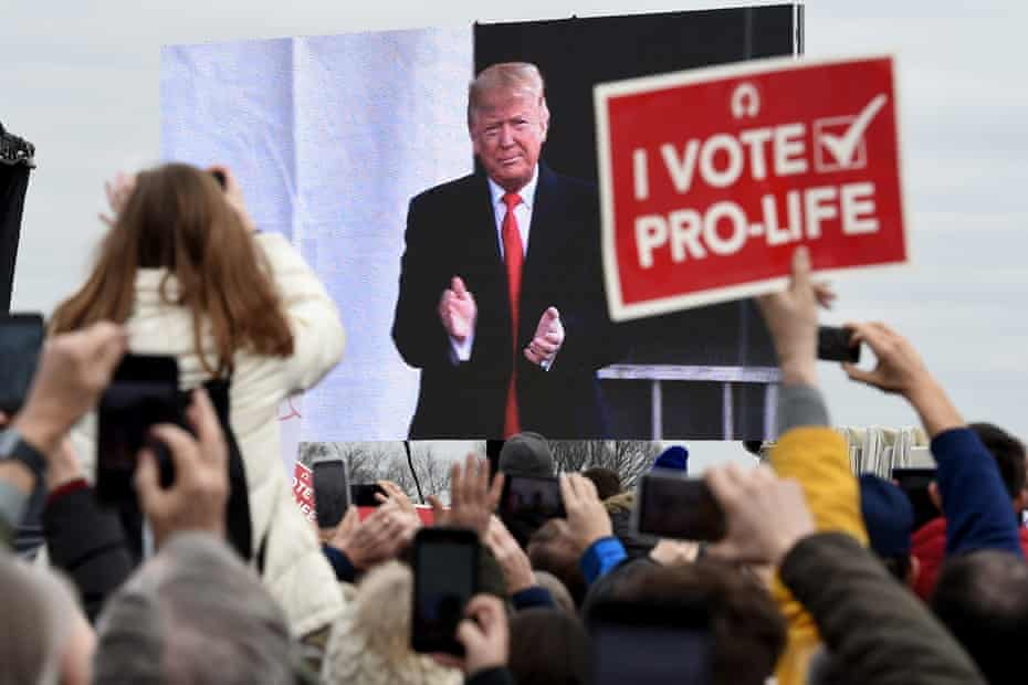 """Pro-life demonstrators listen to US President Donald Trump as he speaks at the 47th annual """"March for Life"""" in Washington, DC, on January 24, 2020."""