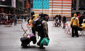 A man walks through New York City's Times Square with his belongings