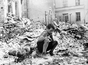 A Polish boy in the ruins of a street in Warsaw in September 1939.