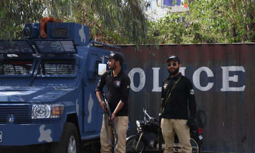 Police officers stand guard outside the French consulate in Karachi, Pakistan.