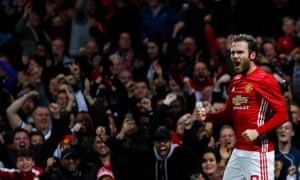 Mata celebrates scoring their first goal as the United faithful celebrates in the stands.