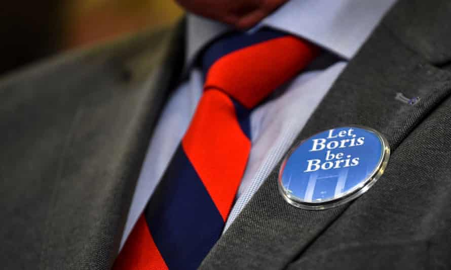 Man wears a badge reading 'Let Boris be Boris' at a Tory hustings in Exeter
