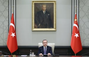 President Erdoğan chairs a cabinet meeting, sitting beneath a portrait of the Turkish republic's founder Mustafa Kemal Atatürk,