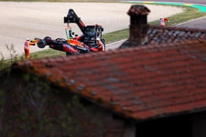he car of Sergio Perez and Red Bull is removed from the circuit after stopping on track during practice ahead of the F1 Grand Prix in Imola, Italy