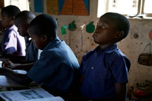 Grade three children (aged 8-9) at the Mutenda Primary School affected by hunger and exhaustion struggle to concentrate in class