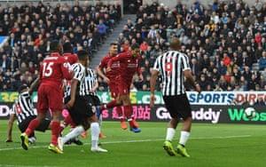 Van Dijk opens the scoring with a towering header.