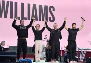 (L-R) Robbie Williams with Howard Donald, Gary Barlow and Mark Owen of Take That on stage during the One Love Manchester Benefit Concert