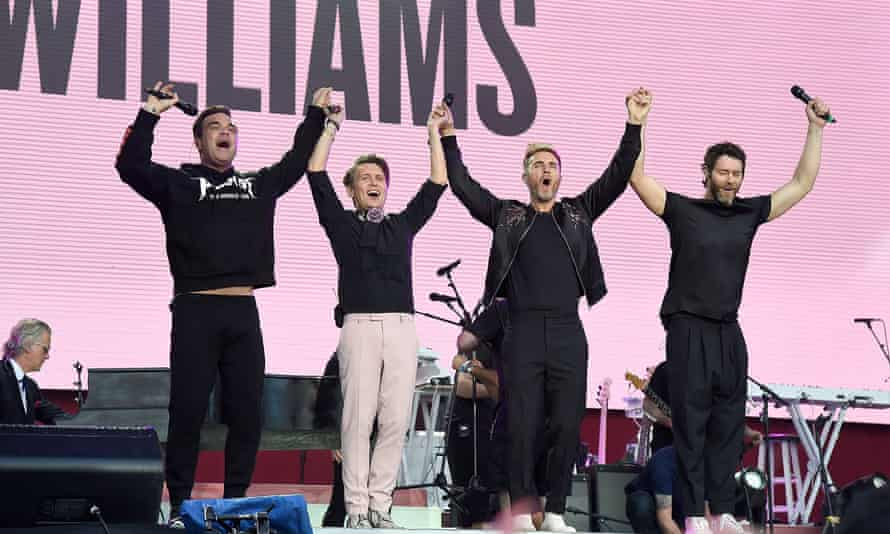 Robbie Williams with Howard Donald, Gary Barlow and Mark Owen of Take That on stage at the One Love concert.