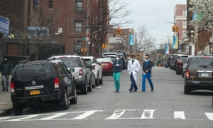 Healthcare workers are seen with face masks in Brooklyn, New York, United States on 25 March, 2020.