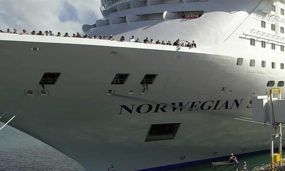 A crowd gathers at a christening ceremony for a Norwegian Cruise Lines ship.