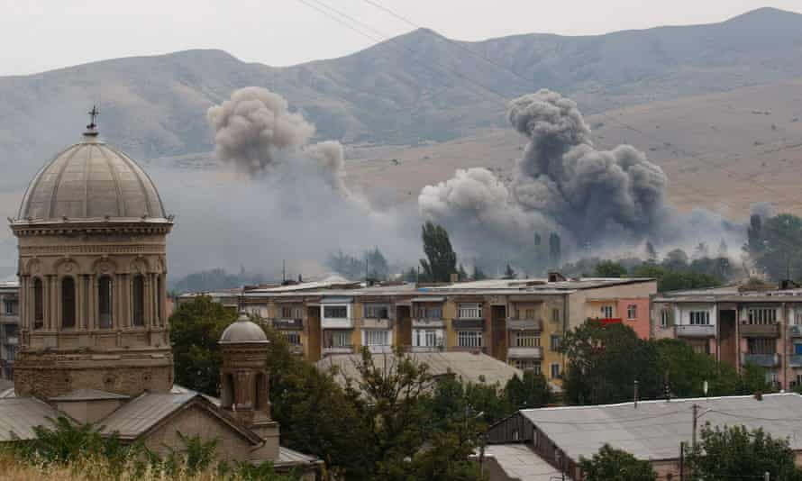 Smoke over buildings after Russian bombardment in Gori, 50 miles from Tbilisi, Georgia, 9 August 2008.