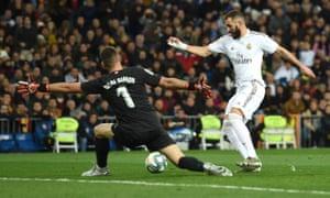 Unai Simon gets the better of Karim Benzema.
