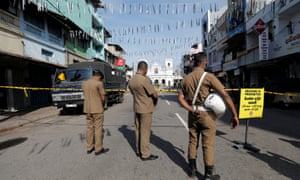 Security personnel observe silence as a tribute to victims near St Anthony Shrine in Colombo.