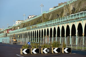 The dilapidated Madeira Terrace on Brighton seafront lies fenced off.