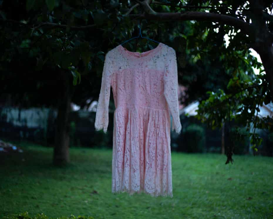 pink dress hanging neatly from tree