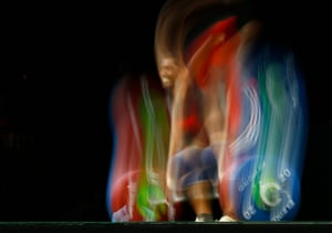 Sri Lanka's Chinthana Vidanage prepares for a lift in the men's 77kg weightlifting final.