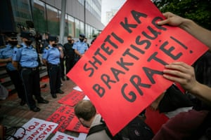 Protesters gather at the Kosovo government building.