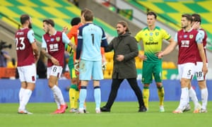 Norwich City manager Daniel Farke, shakes hands with players after the final whistle.