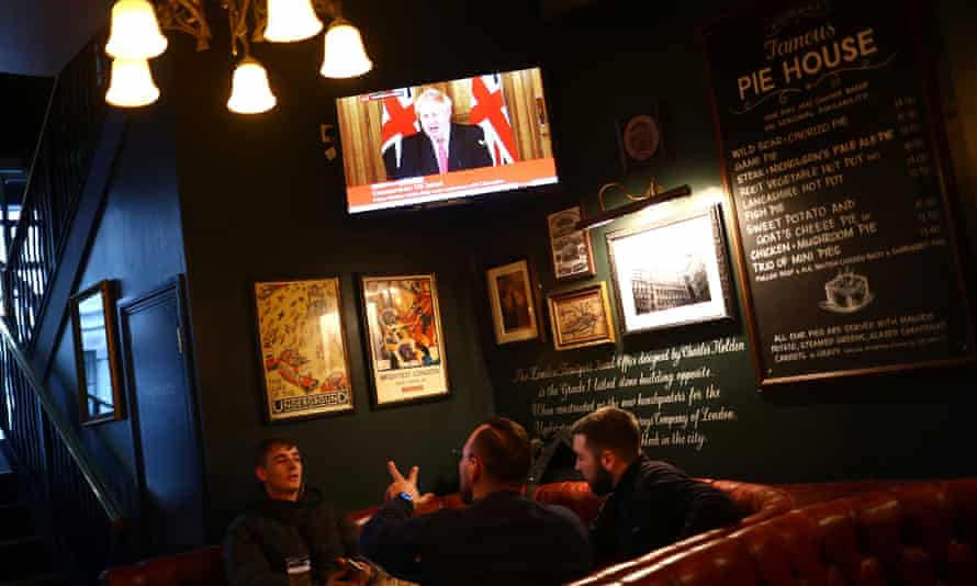 Boris Johnson appears on a television screen in a London pub.