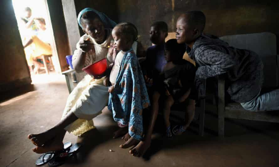 A woman feeds her granddaughter at a camp in Sierra Leone last November. The country is among the worst-performers in a global ranking of children's rights.