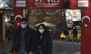 People wearing masks to help protect against the spread of coronavirus, walk along a popular street in Ankara, Turkey, Friday, Nov. 27, 2020.