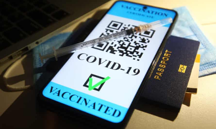 Stock illustration of a medical syringe, a passport and a smartphone with text saying 'Vaccination certificate Covid-19, vaccinated'