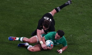 Ireland's fly-half Joey Carbery is tackled by New Zealand's full-back Beauden Barrett in their quarter-final.