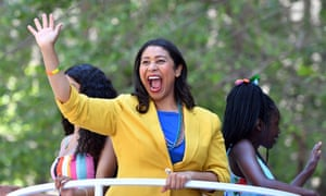 San Francisco's next mayor, London Breed, waves to a cheering crowd atop a float