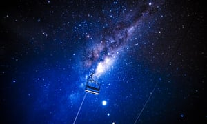 The Milky Way is seen in the night sky beyond a chair  lift in the New South Wales ski resort of Charlotte Pass