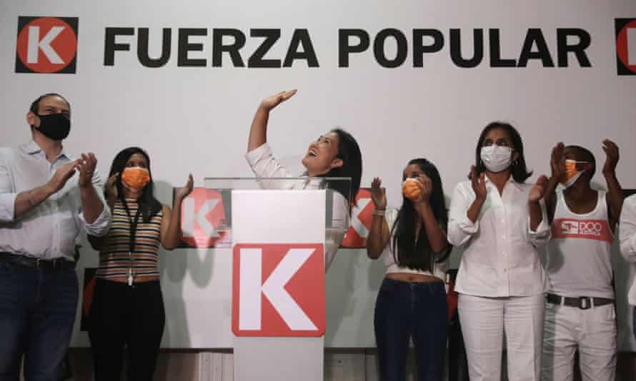 Keiko Fujimori waves during a speech at party headquarters in Lima, Peru, on 11 April.