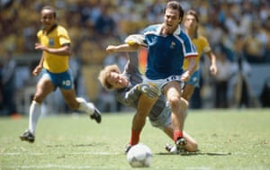 Brazil's Carlos hauls back Bruno Bellone in the closing moments of their 1986 World Cup quarter-final