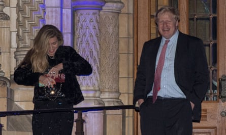 Carrie Symonds at the Conservatives' Black And White Fundraising Ball alongside Boris Johnson