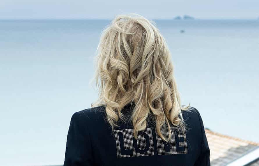 Jill Biden wears a jacket with LOVE on the back