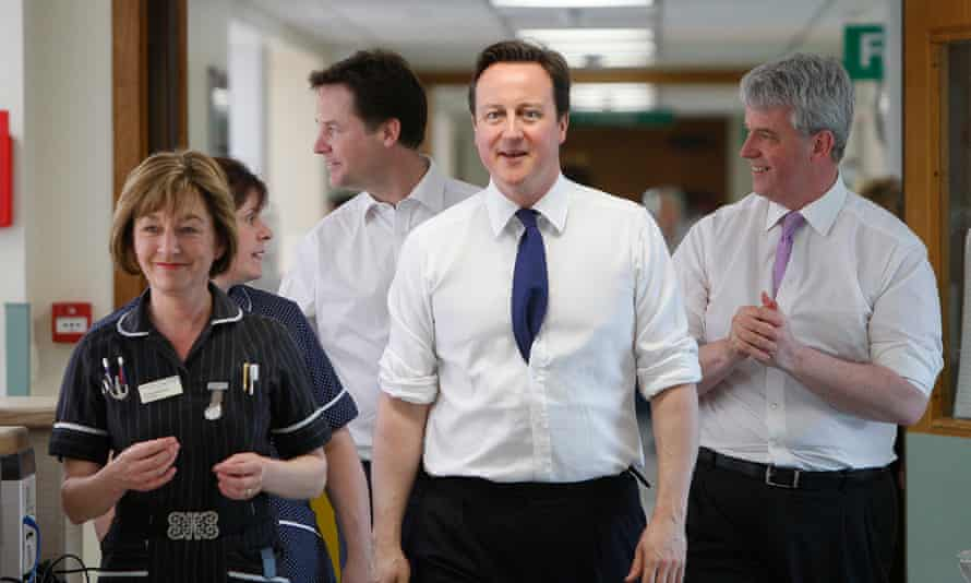 Nick Clegg, David Cameron and Andrew Lansley with Frimley Park Hospital staff in 2011.
