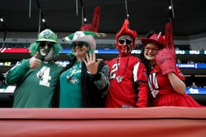 Jets and Falcons fans pose before the game.