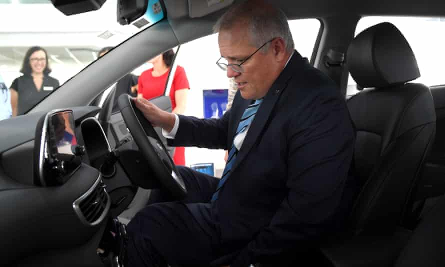 Scott Morrison in a non-electric car.