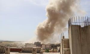 Smoke rises after an airstrike in Idlib