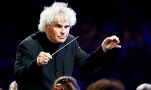 Conductor Simon Rattle takes part in the opening ceremony of the London 2012 Olympic Games