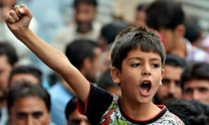 A child shouts during a protest against a police officer who shot dead a local teenager in the Kashmir Valley