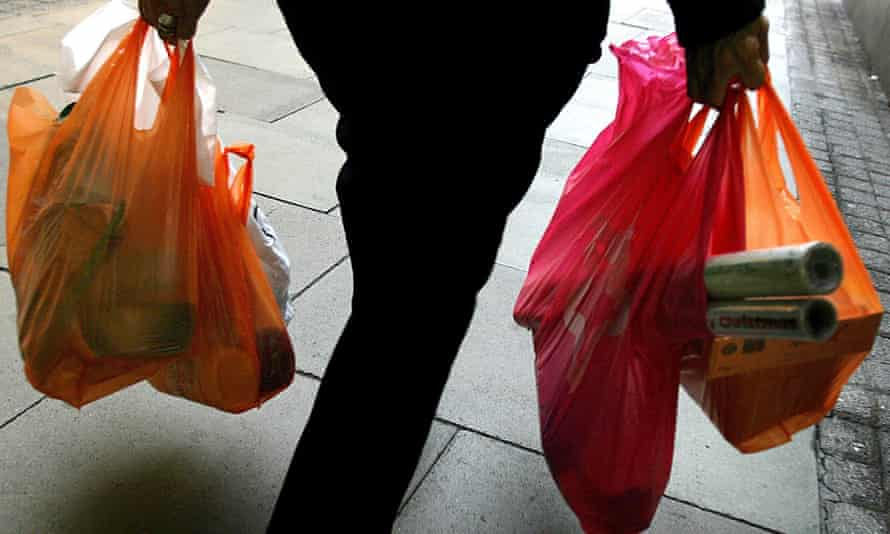 Person carrying plastic bags.