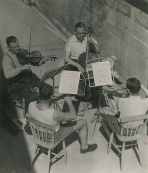 A quartet practising. Refugee musicians gave concerts for the locals.