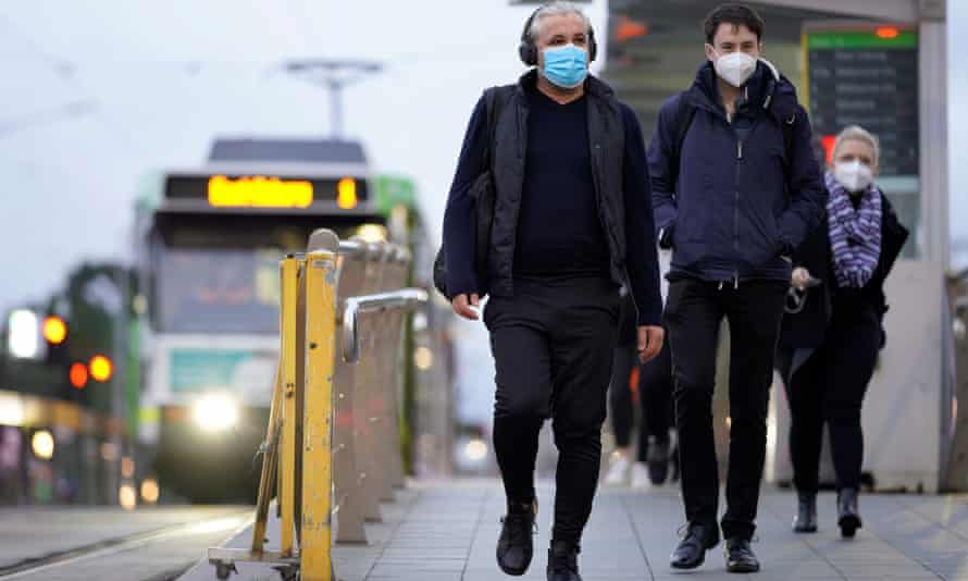 People wear face masks in Melbourne to curb the spread of Covid-19.