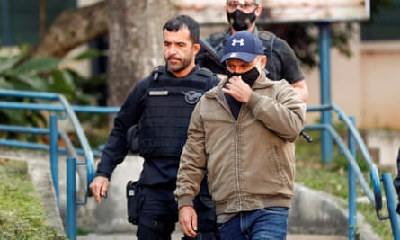 Fabrício Queiroz is led away after being arrested in Atabaia