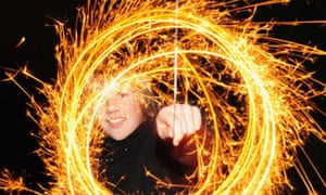 An 11 year old makes light circles with a sparkler