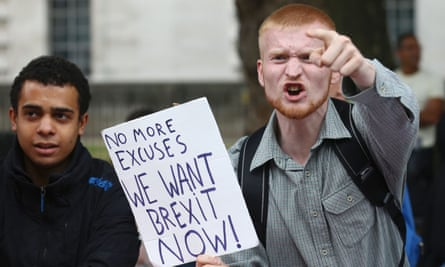 A Brexit supporter shouts at pro-Europe marchers