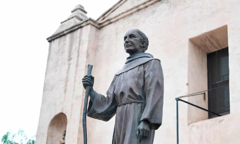 A statue of Father Junípero Serra stands in front of the San Gabriel mission in San Gabriel, California. The Spanish priest is known as the founder of California's mission system, in which Native Americans were subjected to violence and forced labor.