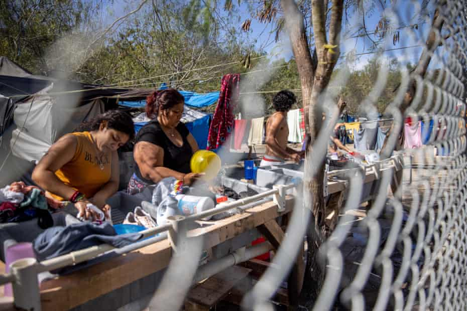 Central American immigrants wash clothing inside a camp for asylum seekers in Matamoros on 7 February.