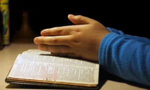 The hands of a child in prayer
